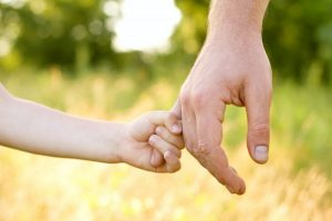 child-holding-fathers-hand-e1380150608693